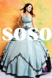 Strapless Taffeta and Tulle ball gown featuring a hand ruched empire waist royal quinceanera dress