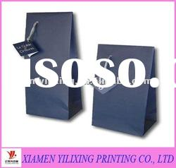 Small size paper comestic bag with hang tag