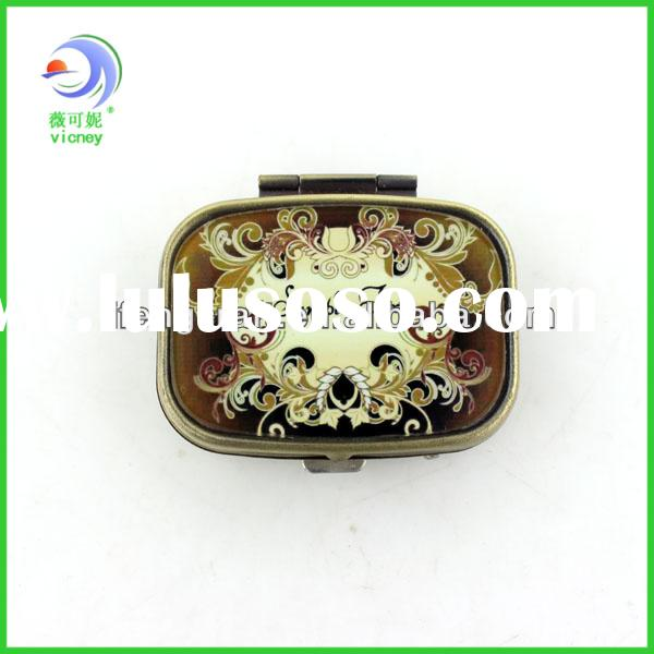small oblong bronze decorative metal 7 day pill box with lock