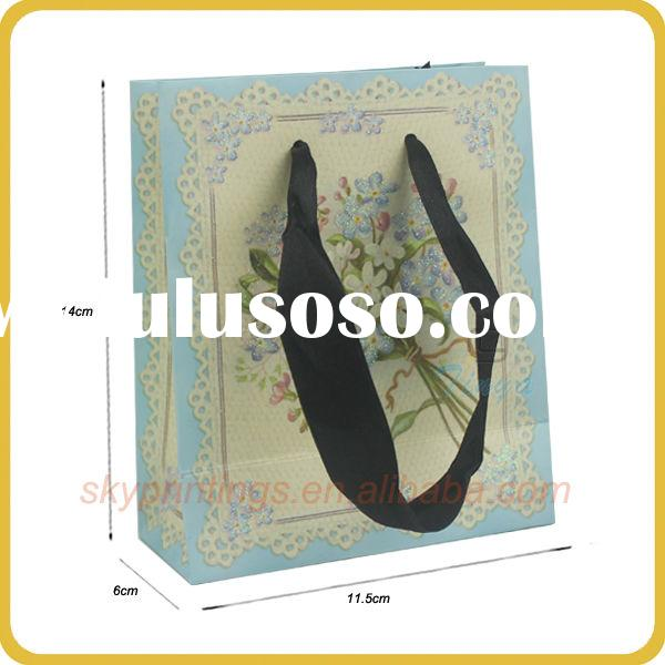 Delicate small colored paper bags with handles for accessory